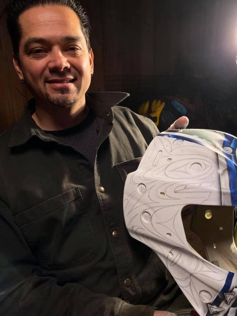 Stzuminus First Nation artist helps design new goalie mask for Canucks